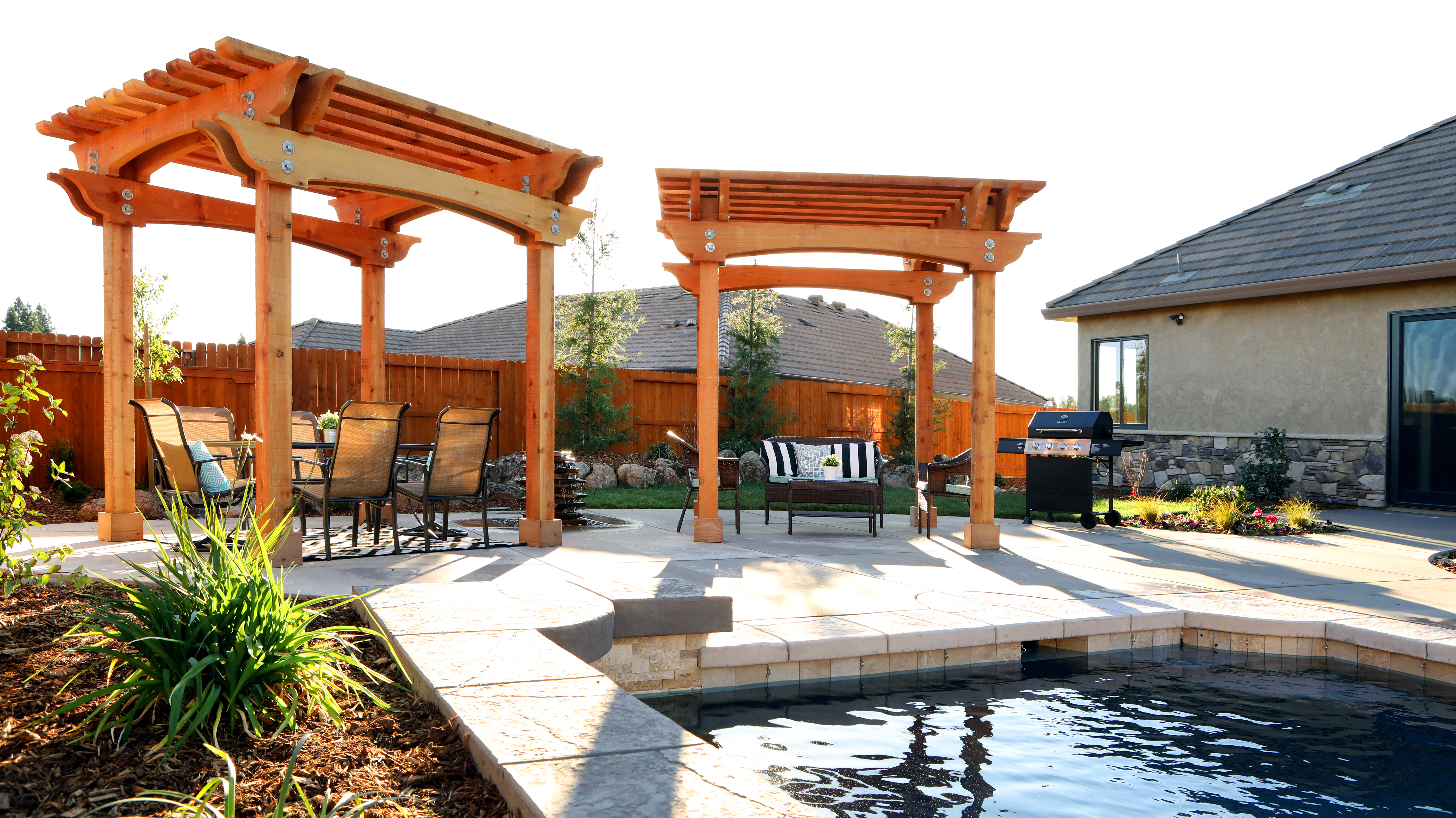 Double Humboldt Redwood Pergolas Enhance Pool Deck on New, Custom Home in Redding, CA